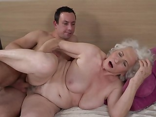 Grey-haired unmasculine gets her hairy cunt fucked by younger boy