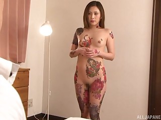 Tattooed Japanese babe with small confidential rides cock like a pro