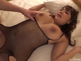 Busty Japanese in fishnets Housaki Yua rides a cock doggy style