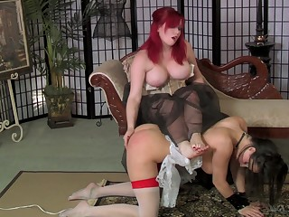 Ample breasted mistress in corset spanks with an increment of fucks submissive slut