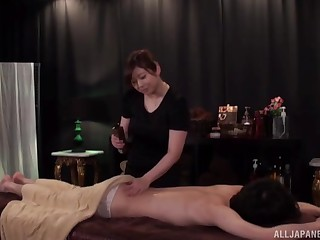 Wild fucking on get under one's massage table with a chunky Japanese darling