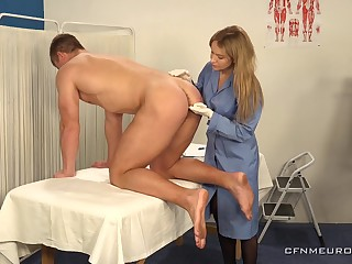 Hot young guy is fucked anally by female physician wearing strapon