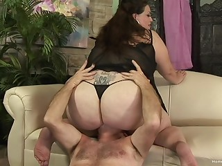 Chubby matured grabs the man's cock and works magic with it