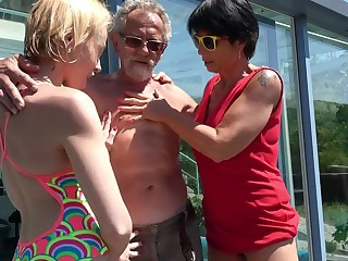 Outdoors FFM threesome between an older couple and younger Darina